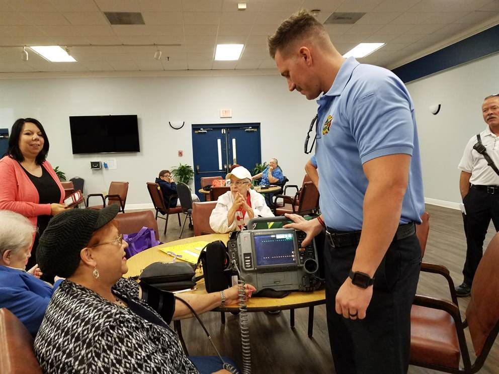 OFD firefighter provides blood pressure checks