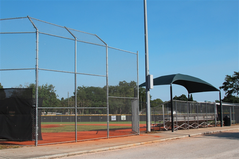 Baseball field with stadium seats in the background.
